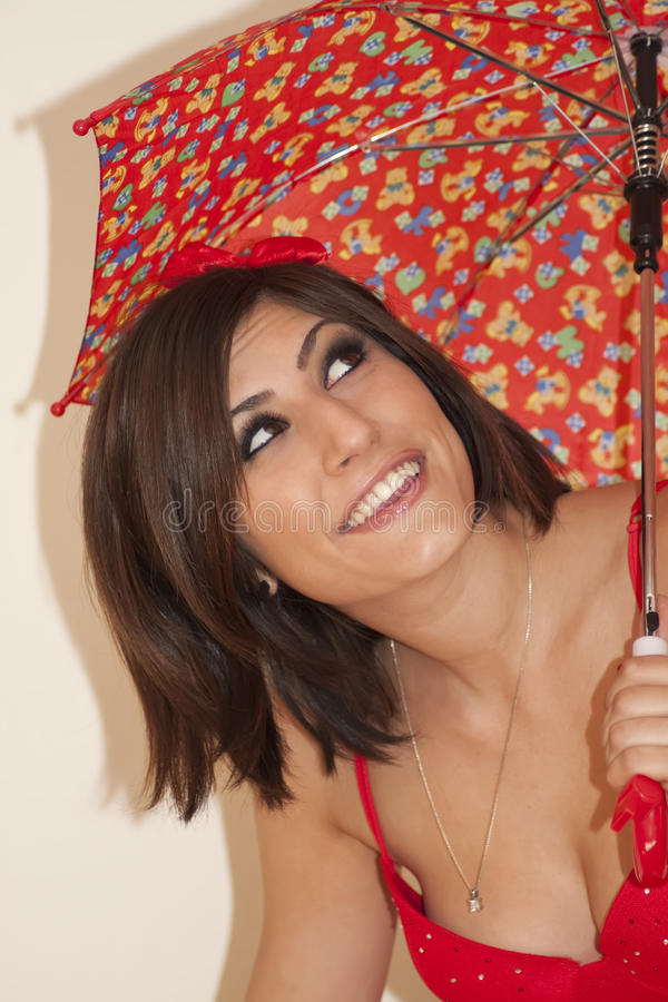 Beautiful young brunette woman with umbrella royalty free stock photography