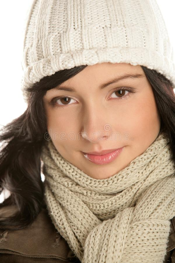 Beautiful young brunette woman wearing a winter outfit with knit stock photo