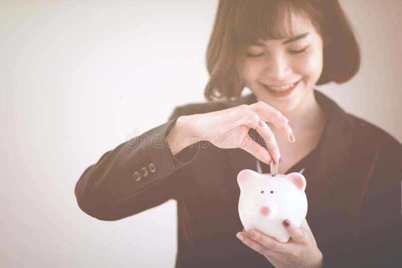 Beautiful young business girl saving money royalty free stock image