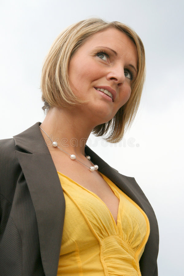 Beautiful young business Woman. Beautiful yellow business Woman on Tour stock photos