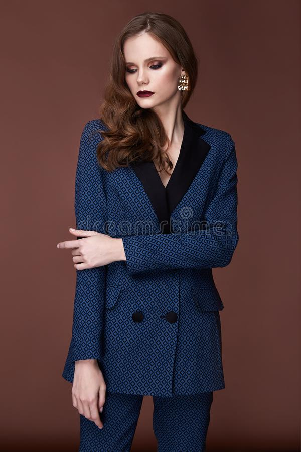 Beautiful young business woman dark hair evening makeup wearing formal suit jacket pants high heels shoes business clothes. For meetings walks autumn spring stock photo
