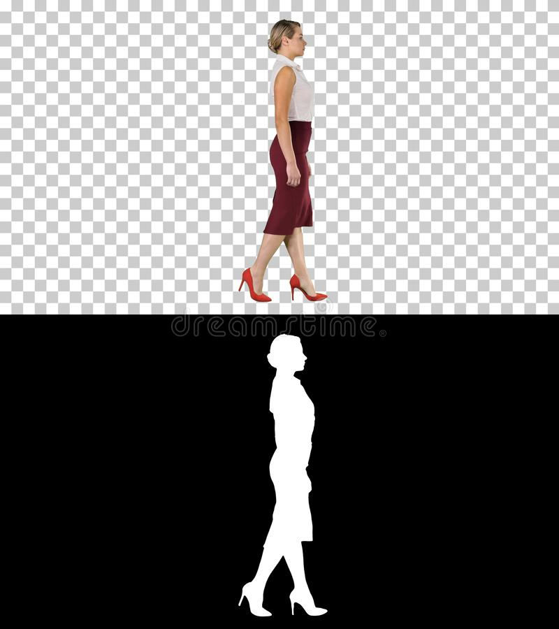 Beautiful young business woman in formal wear walking, Alpha Channel stock image