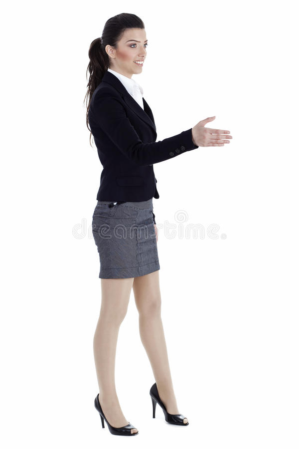 Beautiful young business woman gives open hand