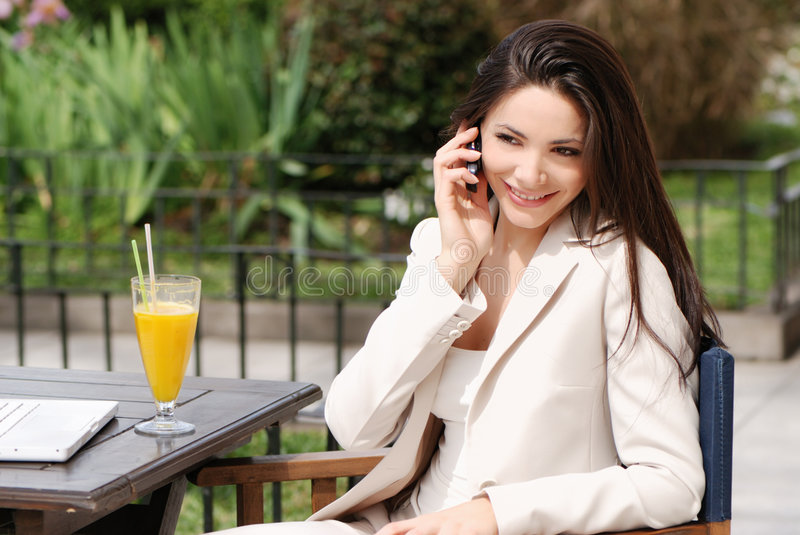Beautiful young Business woman with movil stock images