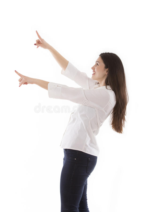 Beautiful young business woman pointing stock photos