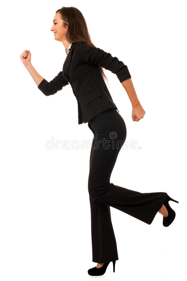 Beautiful young business woman running isolated over white background stock photography