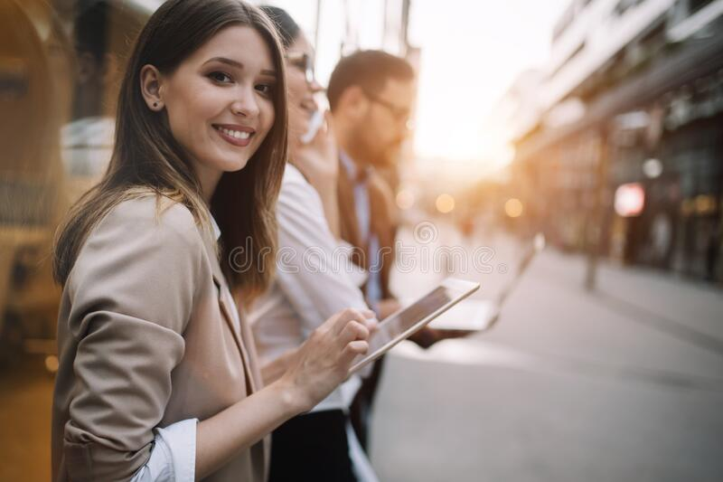 Beautiful young business woman using her tablet on her way from work. royalty free stock image