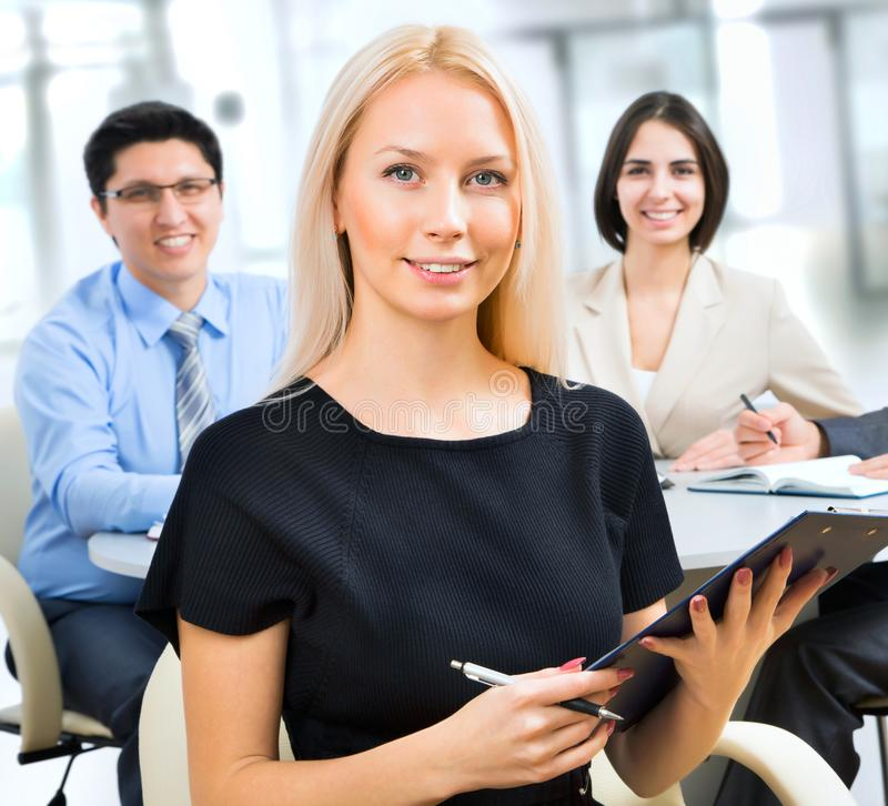 Business woman with colleagues royalty free stock photos