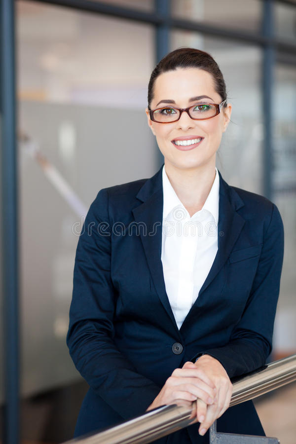 Beautiful young businesswoman. Portrait in office royalty free stock images