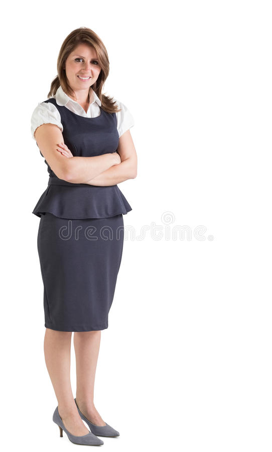 Beautiful young businesswoman with arms crossed stock images