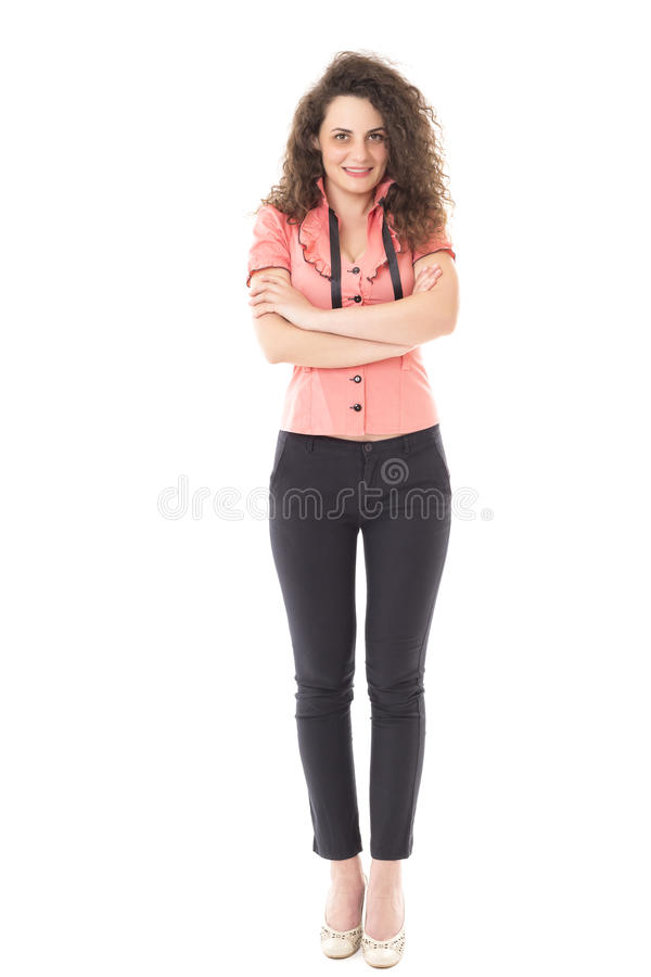 Beautiful young businesswoman with arms folded isolated on white stock photography