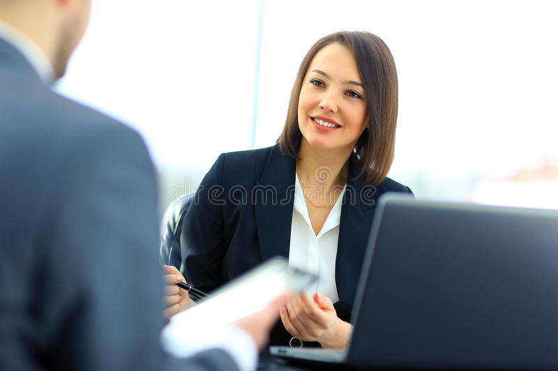 Beautiful young businesswoman conducting stock images