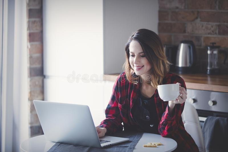 Beautiful young businesswoman have a coffee break stock image