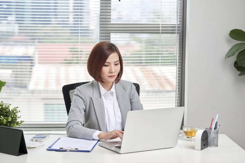 Beautiful young businesswoman in office royalty free stock photos