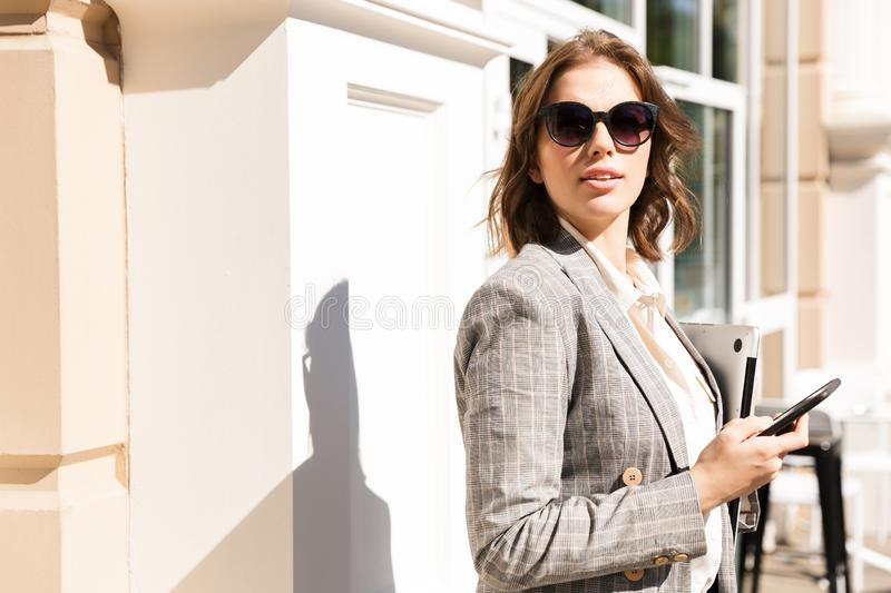 Beautiful young businesswoman wearing jacket stock photos