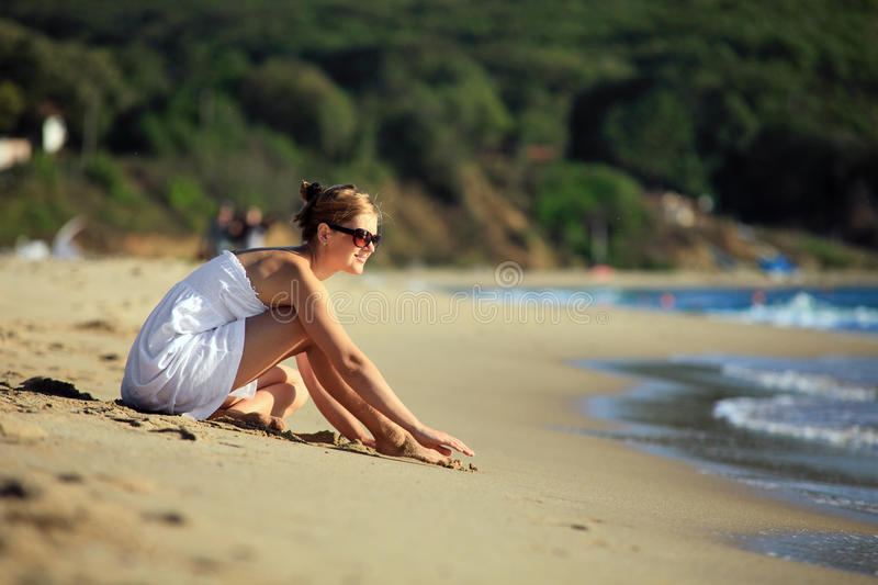 Beautiful young caucasian woman on the be royalty free stock photo
