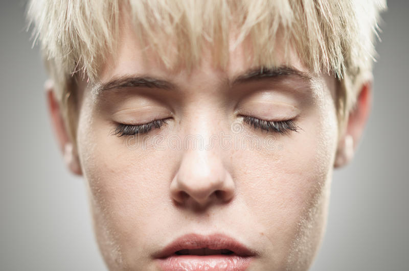 Beautiful Young Caucasian Woman With Her Eyes Closed royalty free stock photo