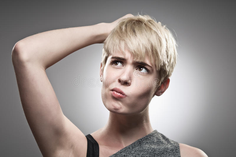 Beautiful Young Caucasian Woman Scratching Her Head royalty free stock photo