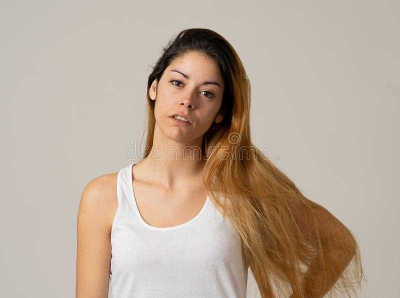 Human expressions and emotions. young worried woman thinking and looking up wondering stock photo