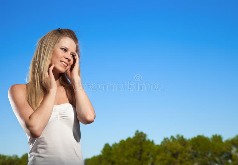 Beautiful young cheerful woman stock photos