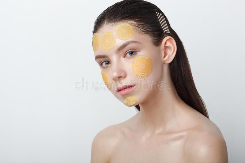 Beautiful young cheerful woman with mask on her face on white background royalty free stock photography