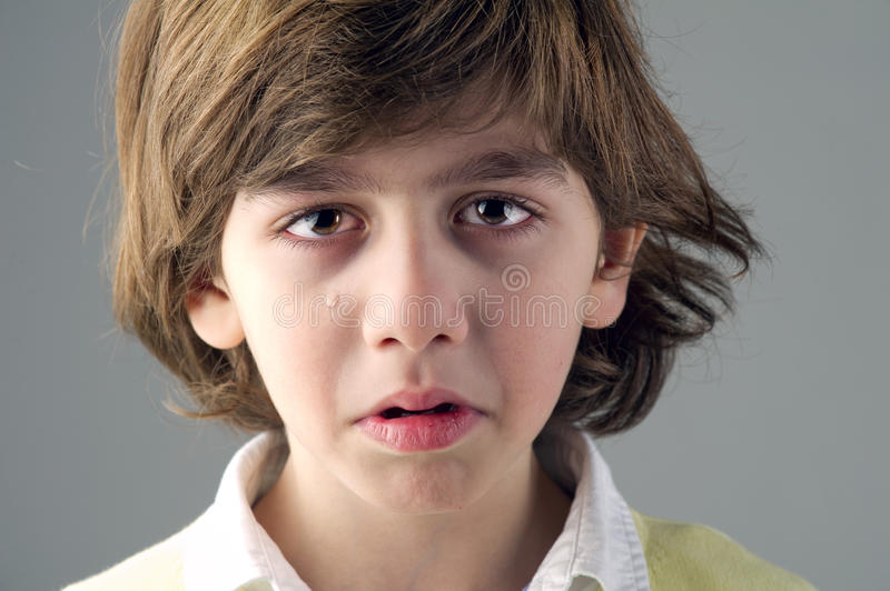Beautiful young child crying royalty free stock photos