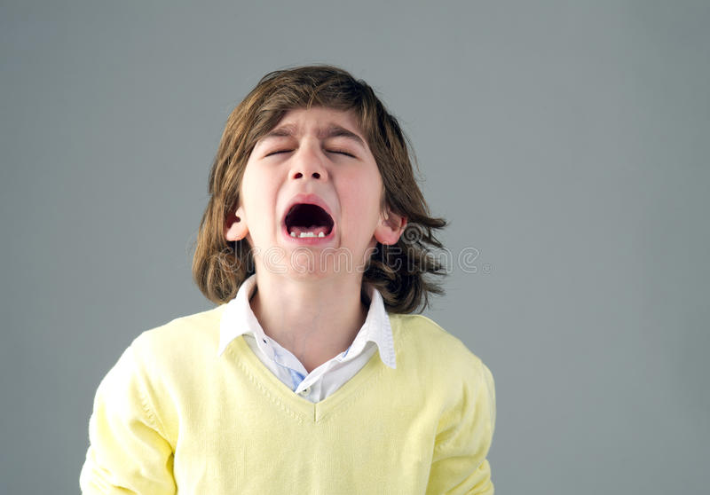 Beautiful young child crying. Isolated stock images