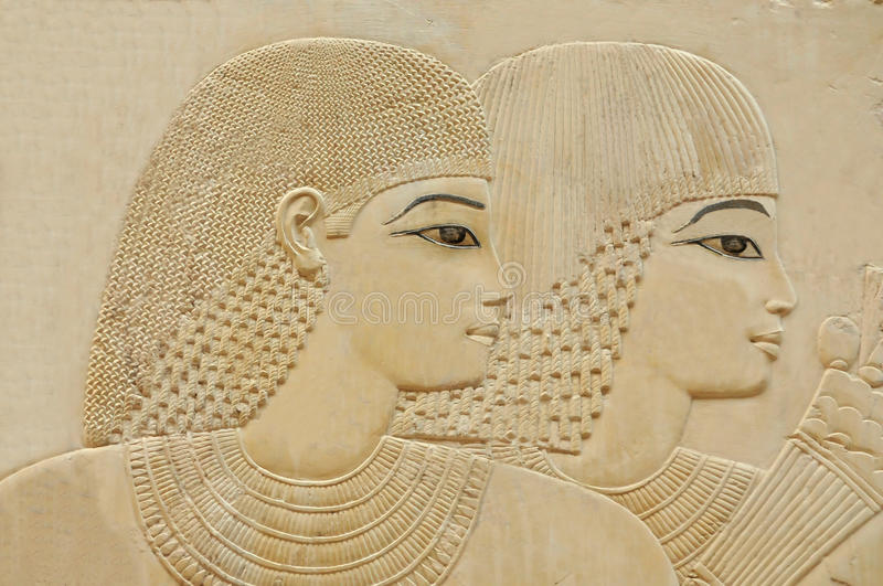 Beautiful young couple. Exquisite relief portrait of beautiful young couple in an ancient egyptian tomb, at the necropolis of the nobles at thebes near Luxor royalty free stock images