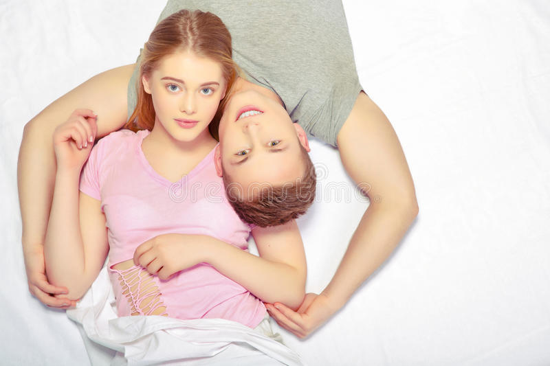 Beautiful young couple in bed royalty free stock photo