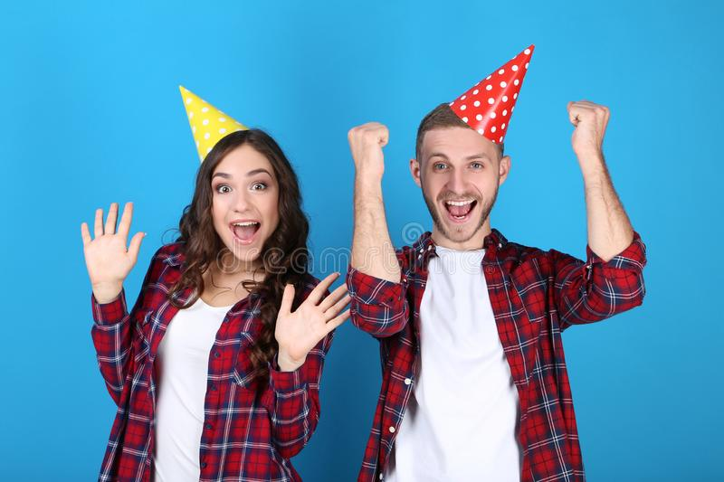Young couple in birthday paper caps royalty free stock photos