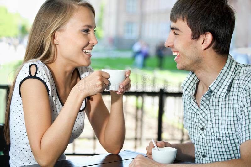 Beautiful young couple at cafe royalty free stock image