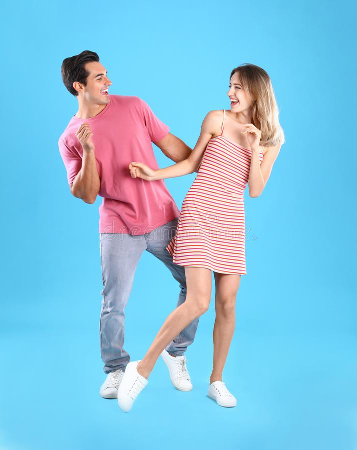 Beautiful young couple dancing on background royalty free stock photos