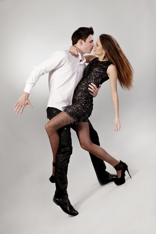 Download Beautiful Young Couple Are Dancing On Grey Stock Image - Image: 25127345