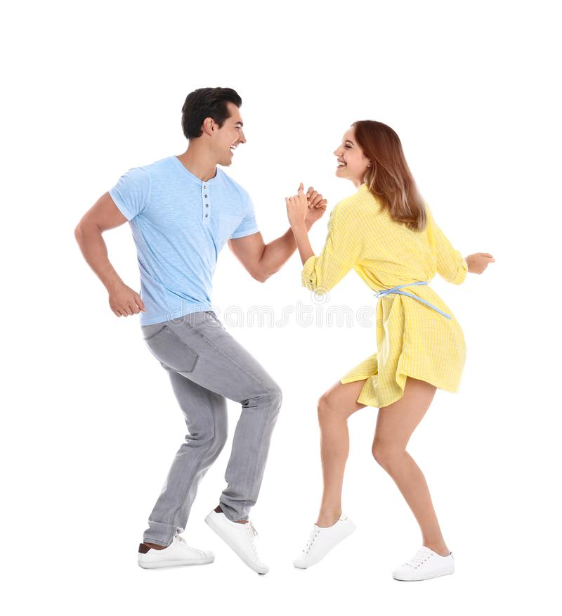 Beautiful young couple dancing on background royalty free stock image