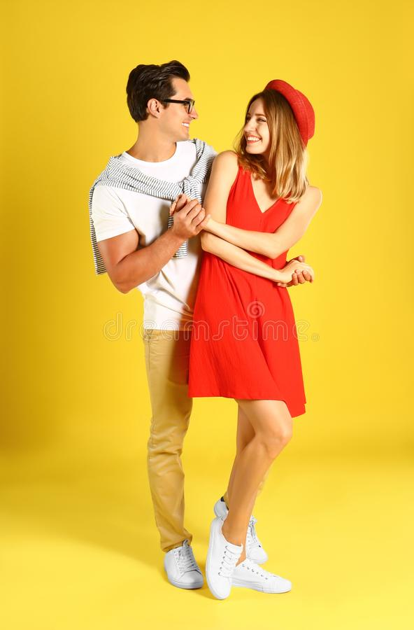Beautiful young couple dancing on background stock photo
