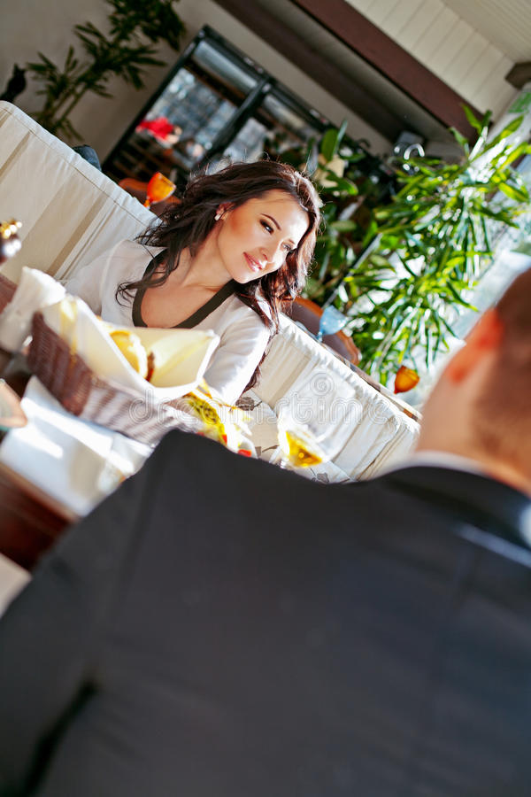 Beautiful young couple dating at the restaurant. royalty free stock photos