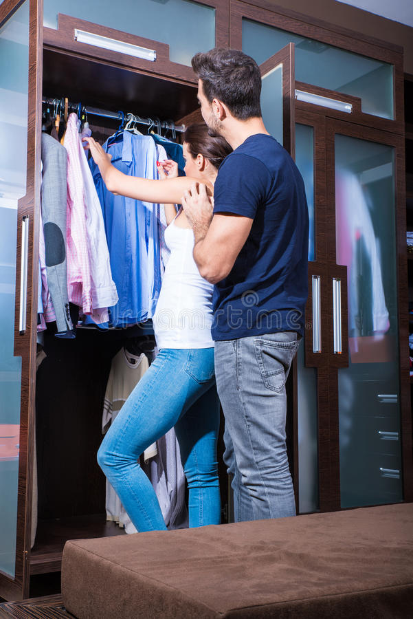 Beautiful young couple in the dressing room royalty free stock photos