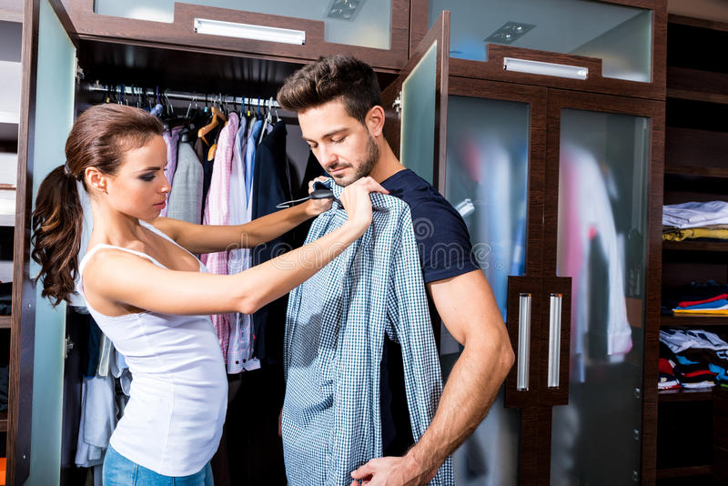 Beautiful young couple in the dressing room royalty free stock photo