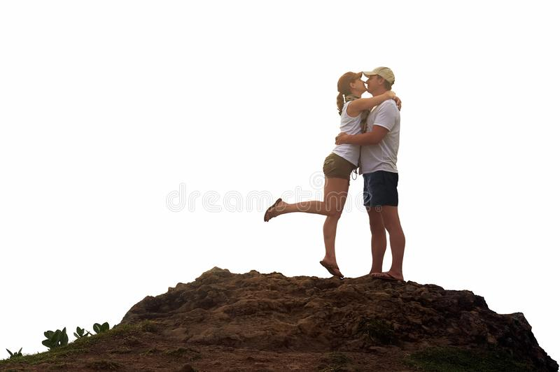 Beautiful young couple embracing and smiling while resting in on royalty free stock photo