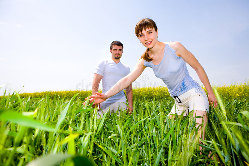 Beautiful young couple are enjoying summer stock images