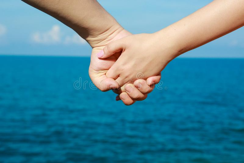 Beautiful young couple hand with hand royalty free stock image