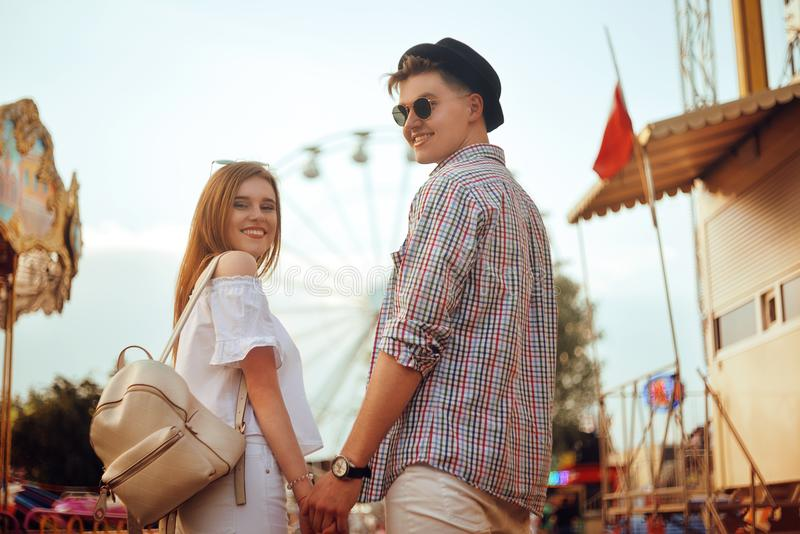 Beautiful, young couple having fun at an amusement park. Couple Dating Relaxation Love Theme Park Concept. Couple posing together royalty free stock photo