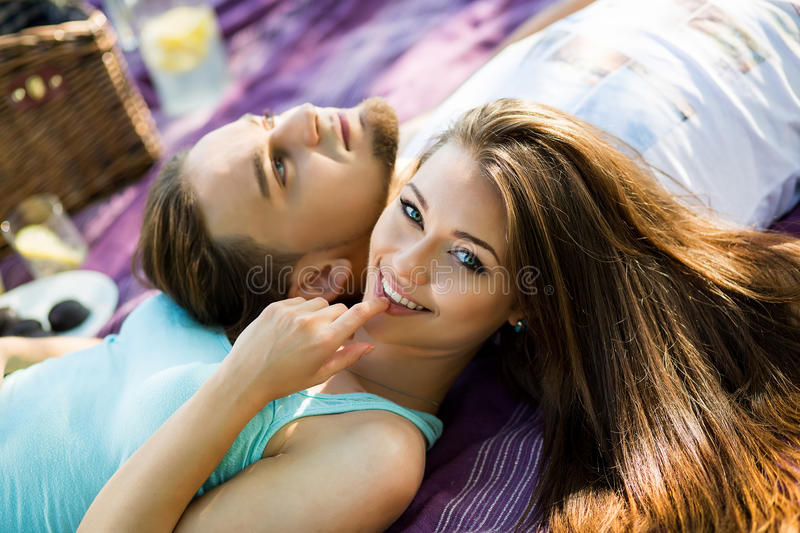 Beautiful Young Couple Having Picnic in Countryside. Happy Family. stock photography