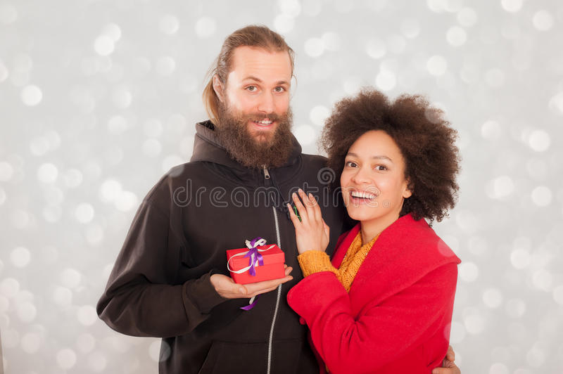 Beautiful young couple holding her gift box royalty free stock photo