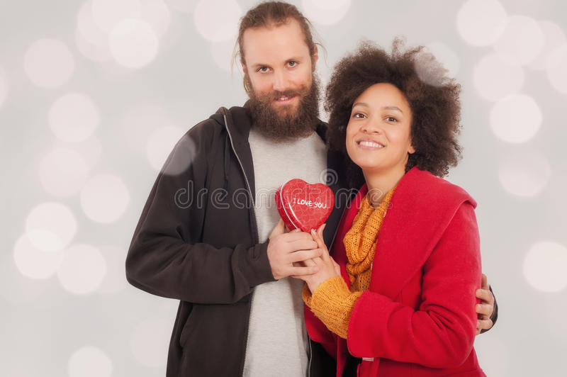 Beautiful young couple holding her gift box stock photo