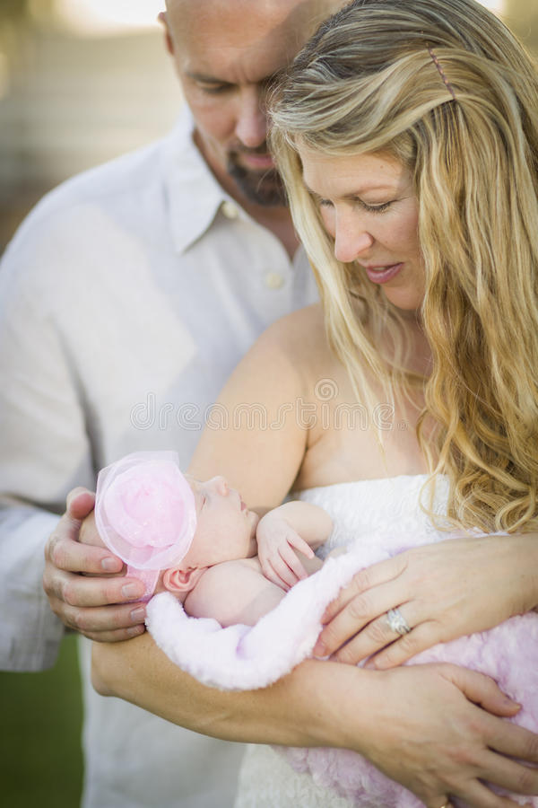 Beautiful Young Couple Holding Their Newborn Baby Girl stock photos