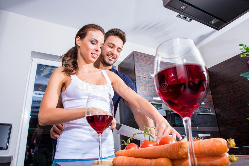 Beautiful young couple in the kitchen stock photo