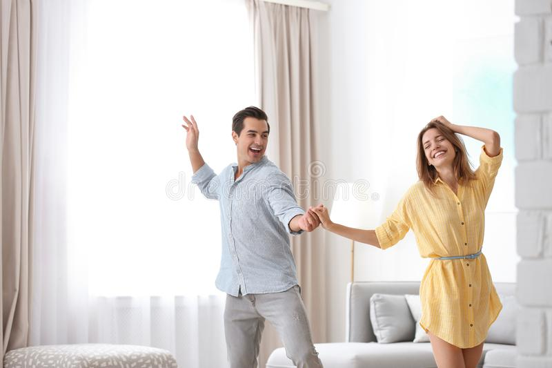 Beautiful young couple  in living at home stock photography