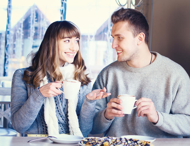 Beautiful Young Couple in Love in cafe stock image