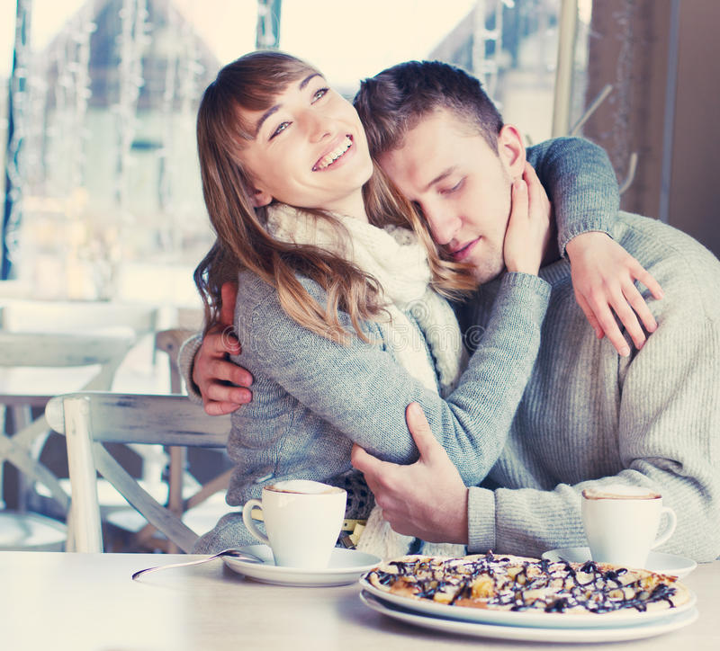 Beautiful Young Couple in Love in cafe royalty free stock photo